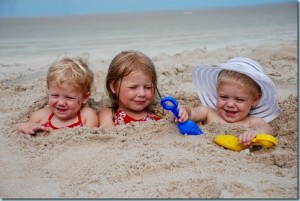 kids buried in sand